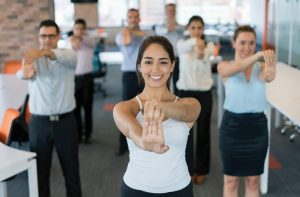 Employees stretching in the workplace