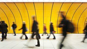 People walking through a station