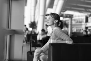 Female traveler in black and white