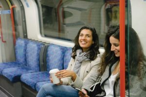 Two young women riding the train