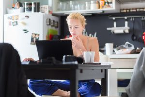 An employer looks at their working from home guide, while working from home