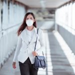 Woman wearing PPE on her return to work