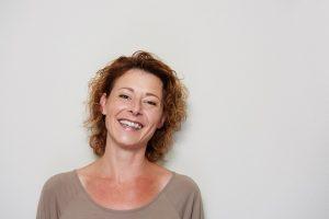 Women smiling, showing good mental health