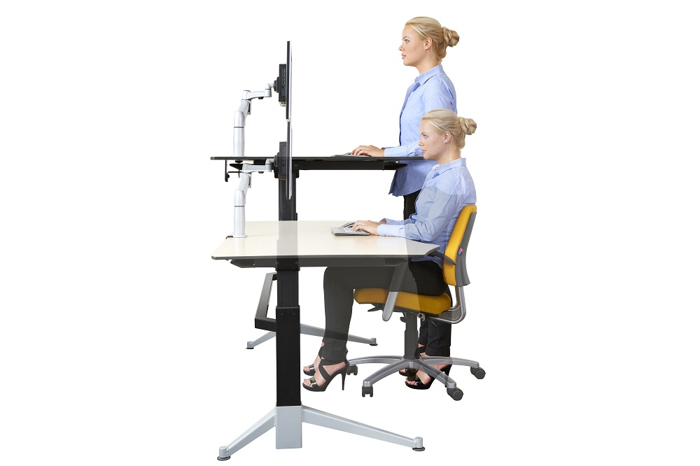 Lady using a sit-stand desk