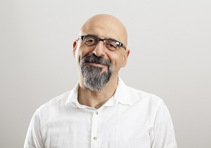 Man with glasses smiles